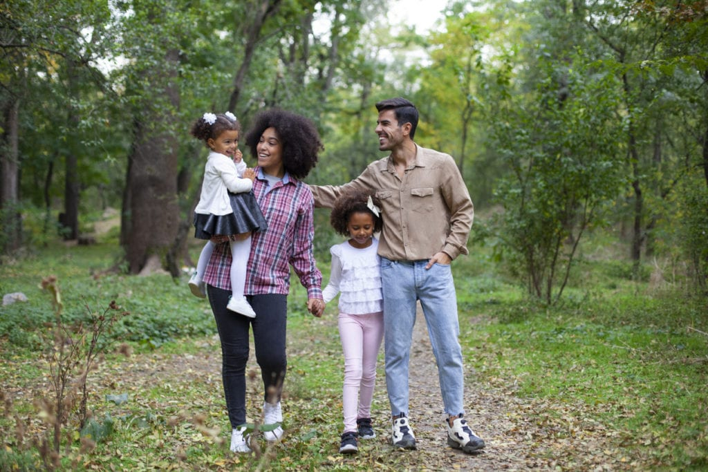 Family enjoying a walk in a nature park